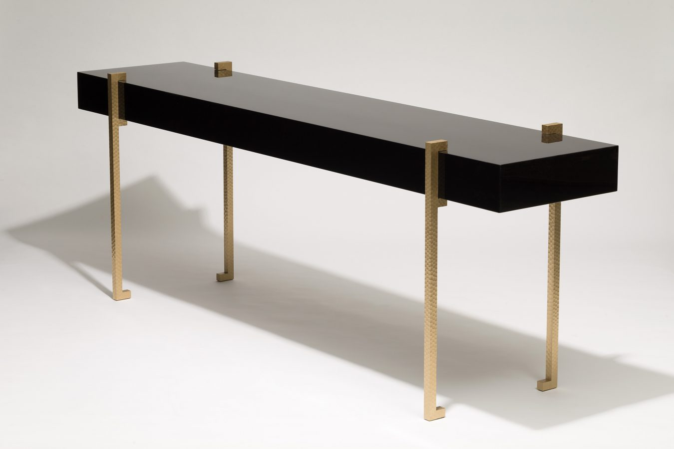 lacquer console with worked brass legs 2