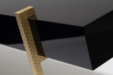 lacquer console table with worked brass legs detail