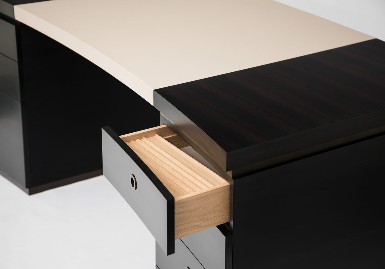 curved ebony and leather desk detail 1