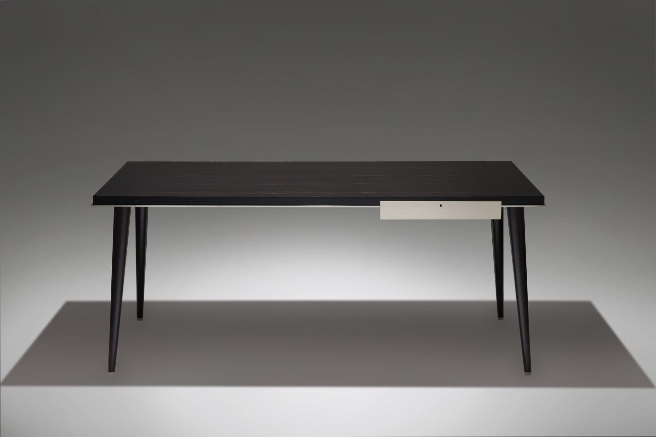 a luxury ebony and nickel desk