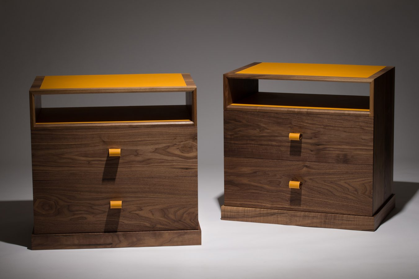 set of walnut bedside cabinets